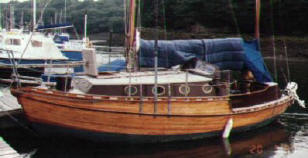 'Chris Hawk' 24'  Strip planked mahogany, the deck is marine ply and the interior is varnished mahogany and ply.